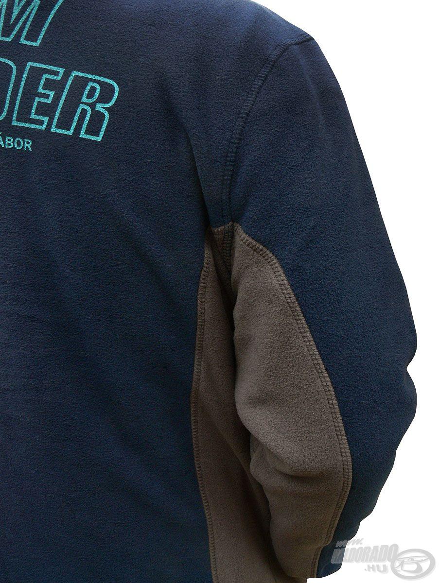 A sötétkék színű kabátot oldalt egy-egy szürke sávval egészítettük ki